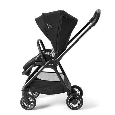 Side view of Nuna triv™ stroller in Caviar and Broken Arrow pattern