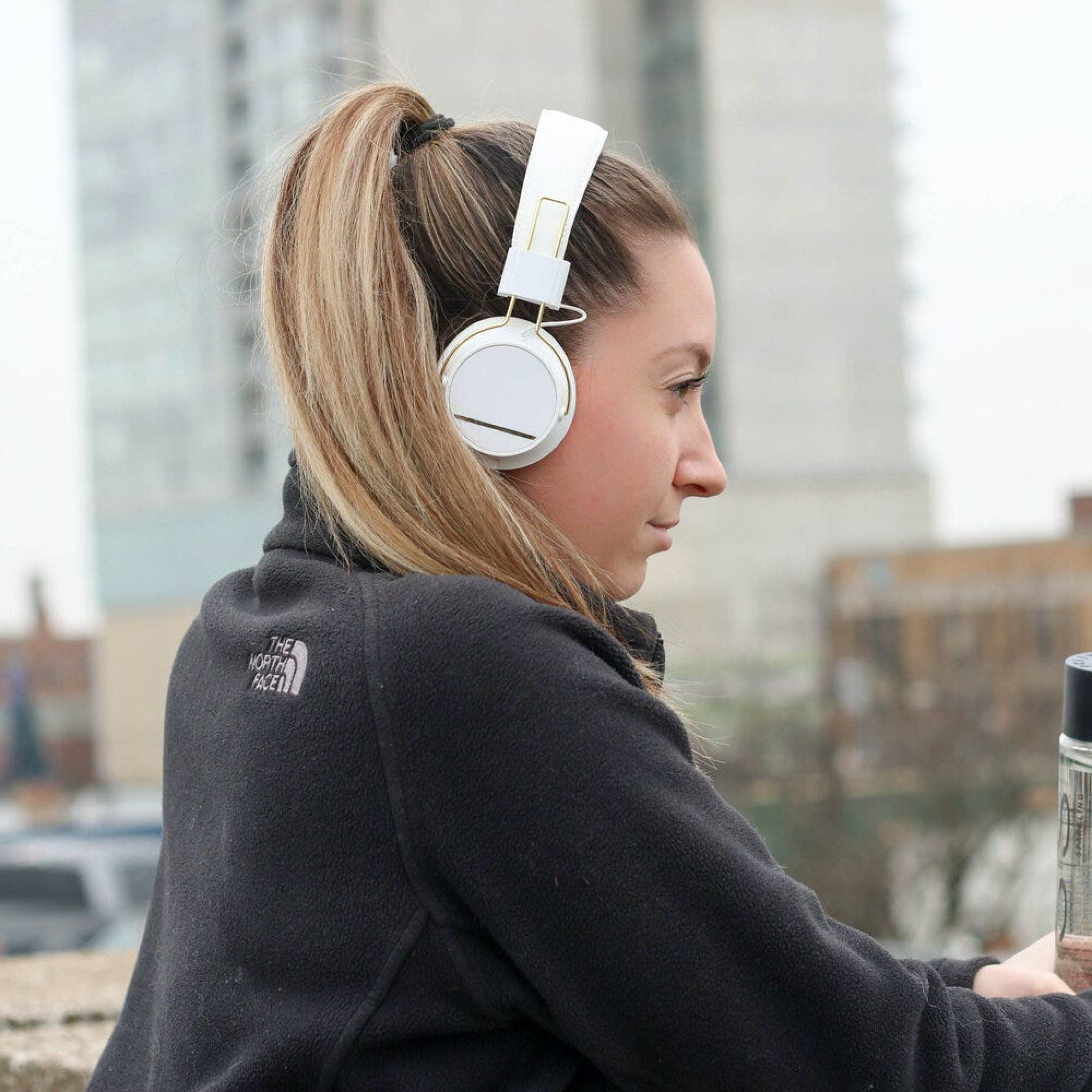 young woman wearing white headphones