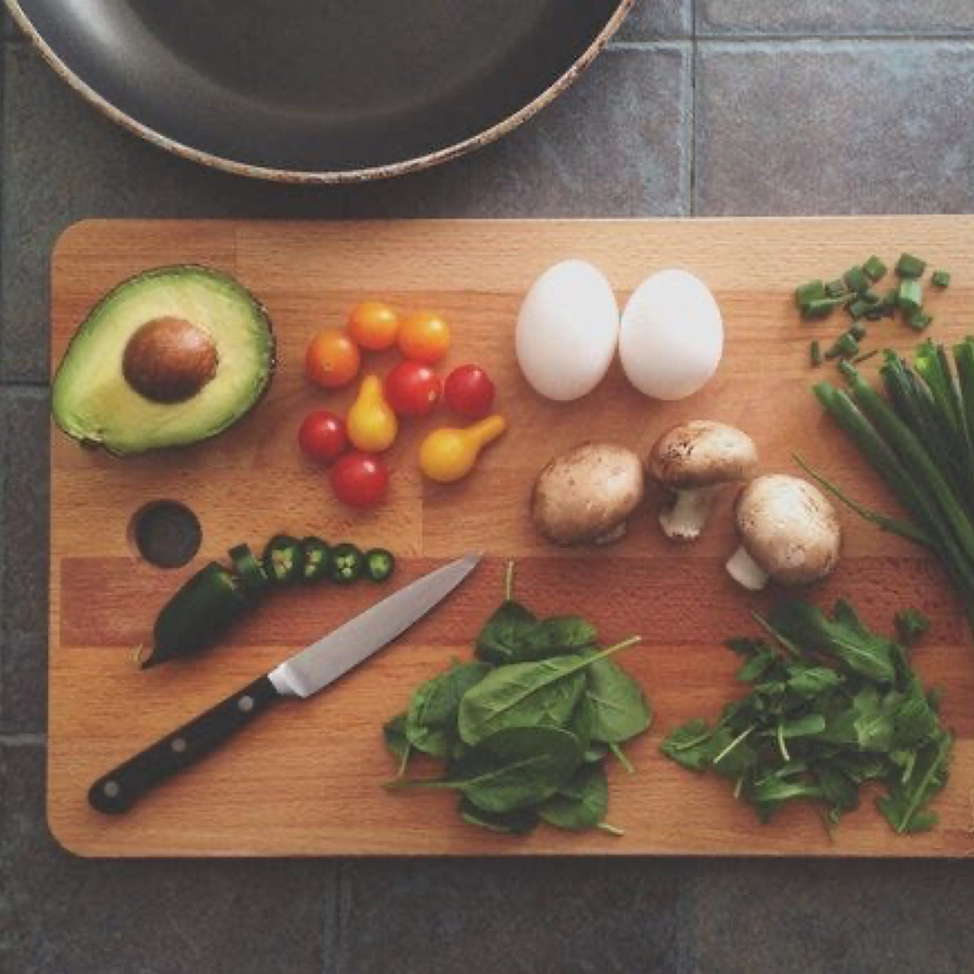 cutting board with food and knife
