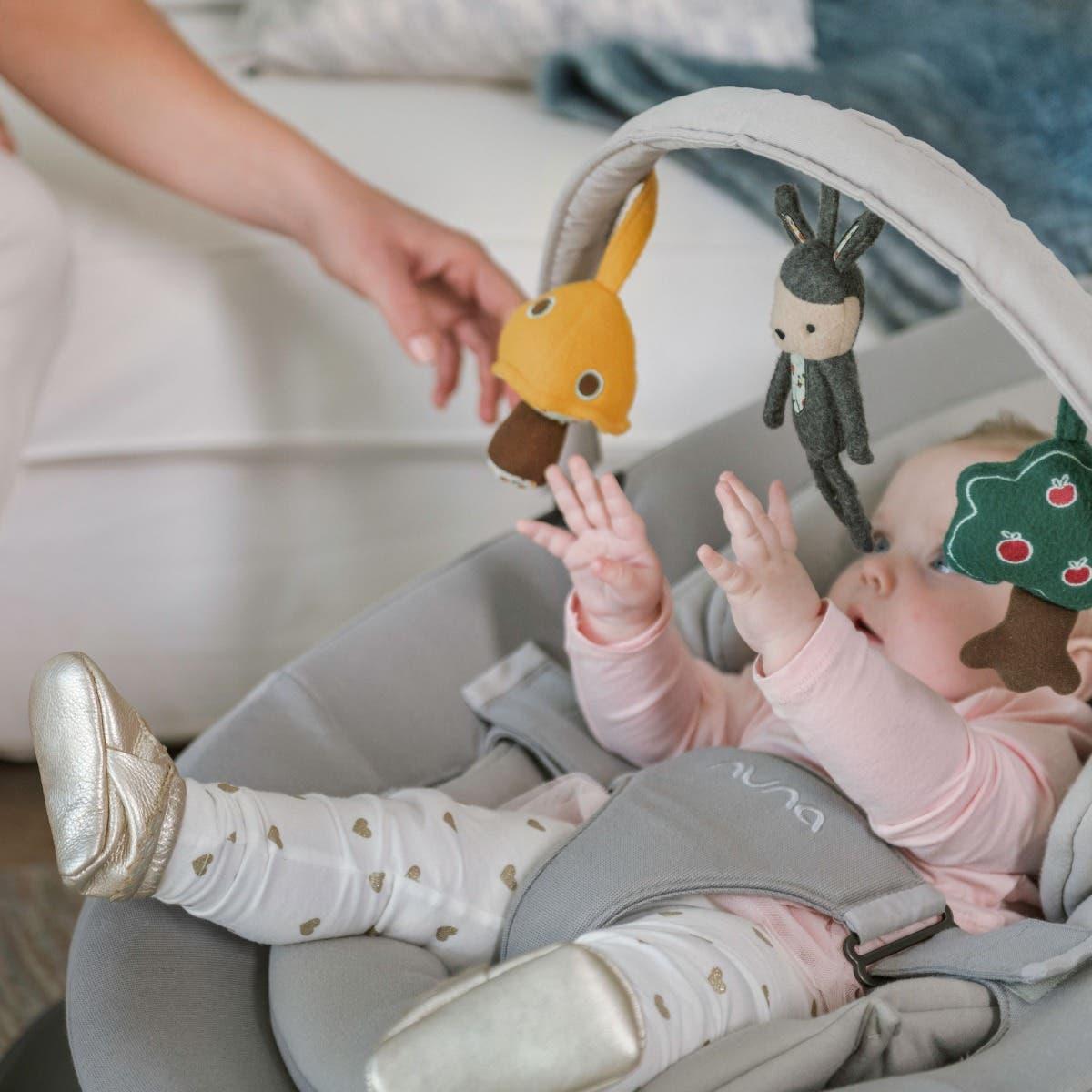 Baby in Nuna LEAF™ grow rocker