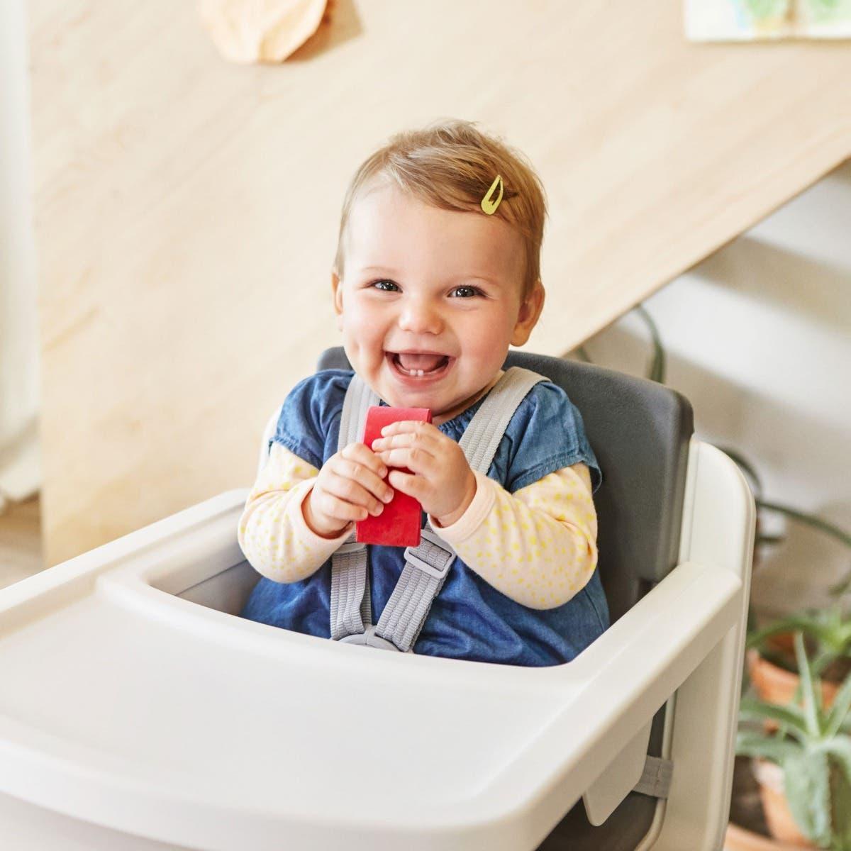 Baby sitting in Nuna ZAAZ™ high chair
