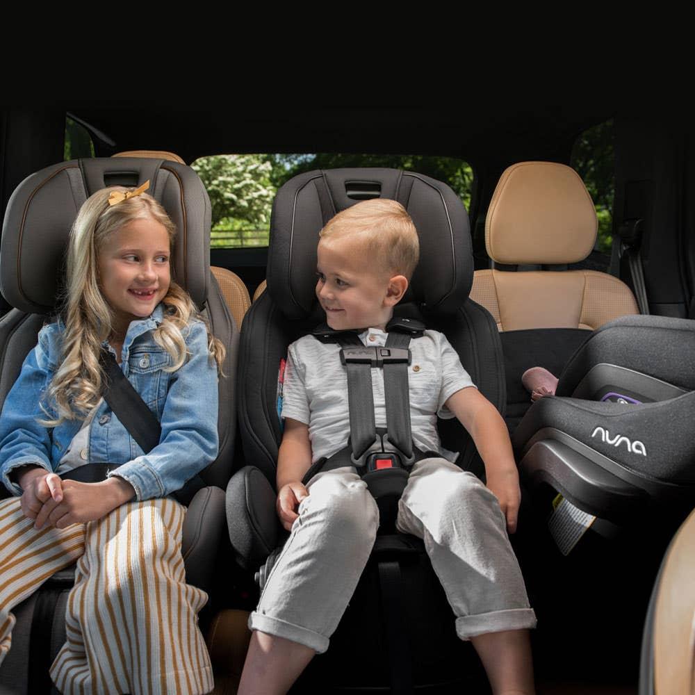 Two kids in Nuna EXEC™ car seats
