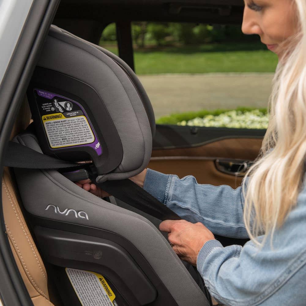 Woman adjusting Nuna EXEC™ car seat