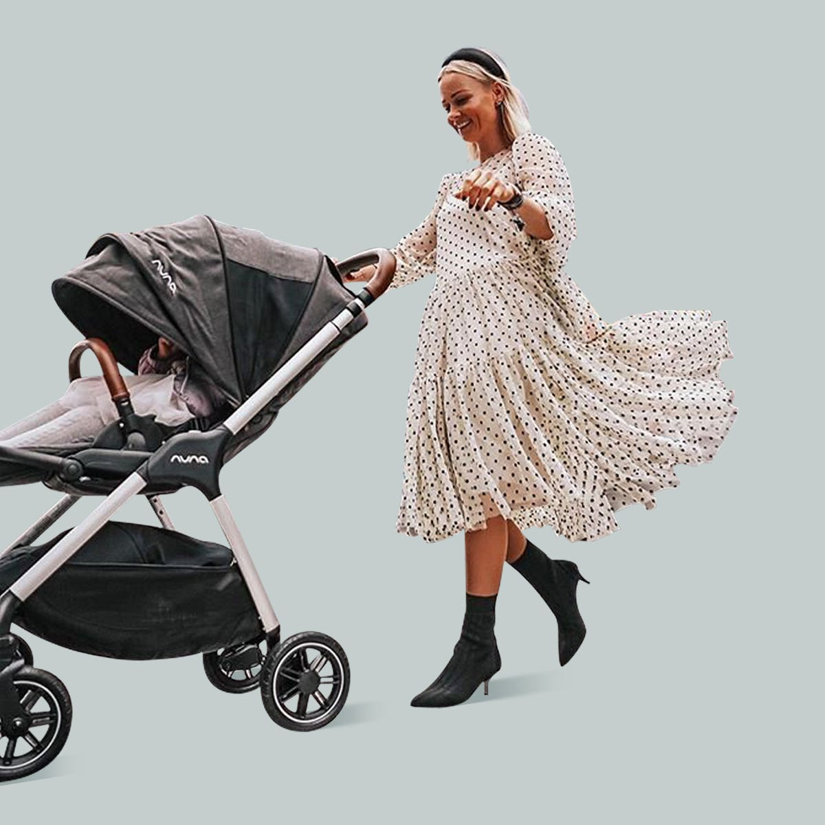 Woman pushing Nuna TRIV™ stroller