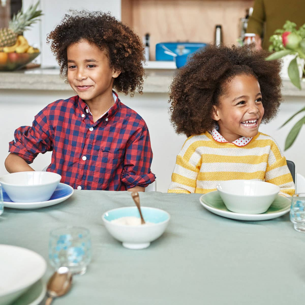 Two kids sitting at table
