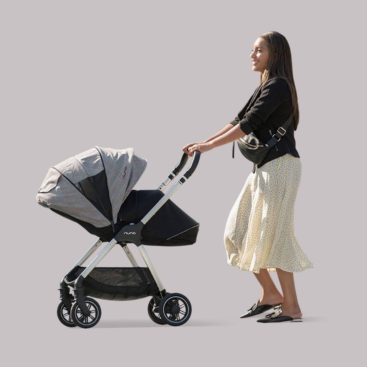 Woman pushing TRIV™ Ellis stroller