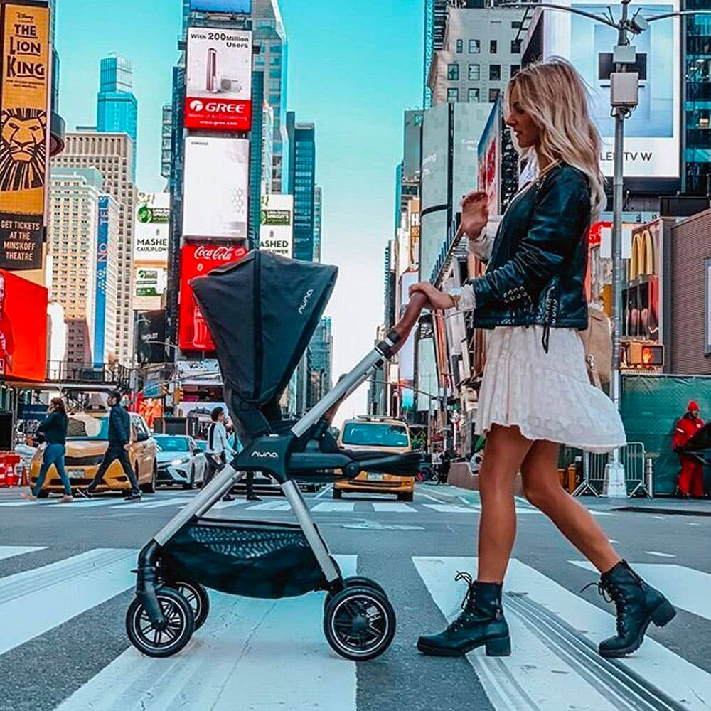 Mom with two kids in Nuna TRIV™ strollers