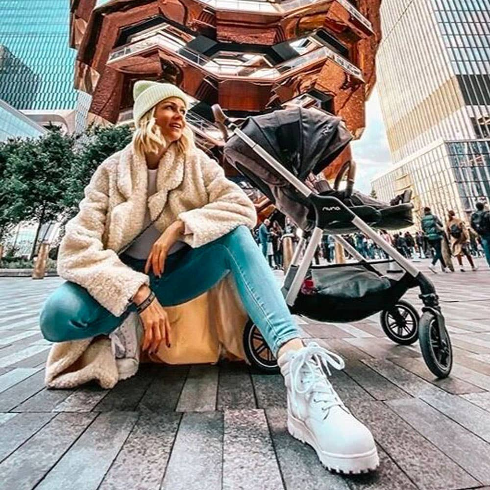 Mom in Times Square with Nuna TRIV™ stroller