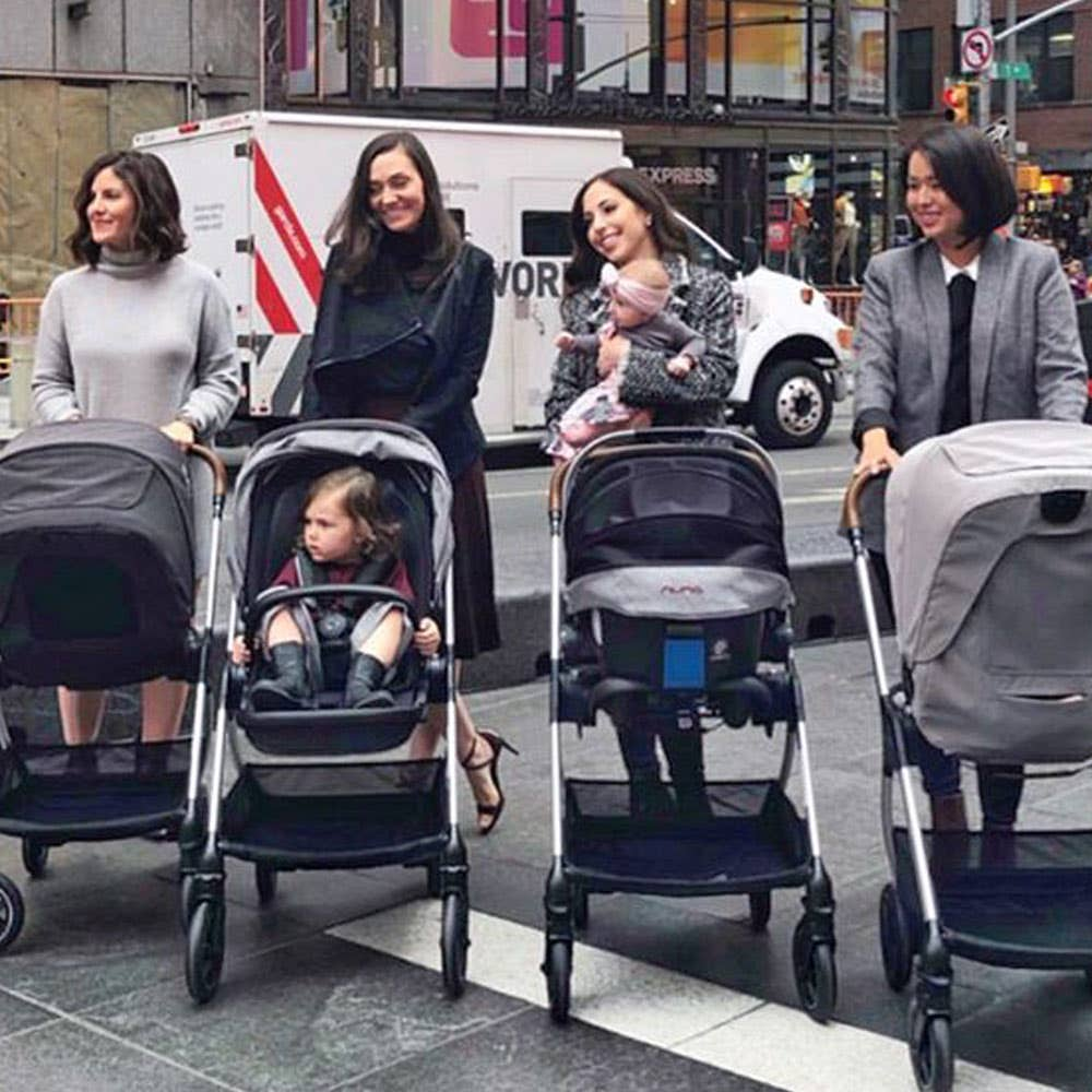 Four moms with Nuna strollers in Times Square